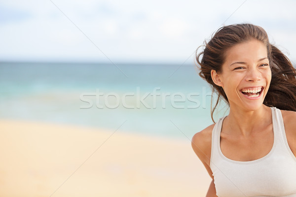 Beach fun - running woman closeup with copy space Stock photo © Maridav