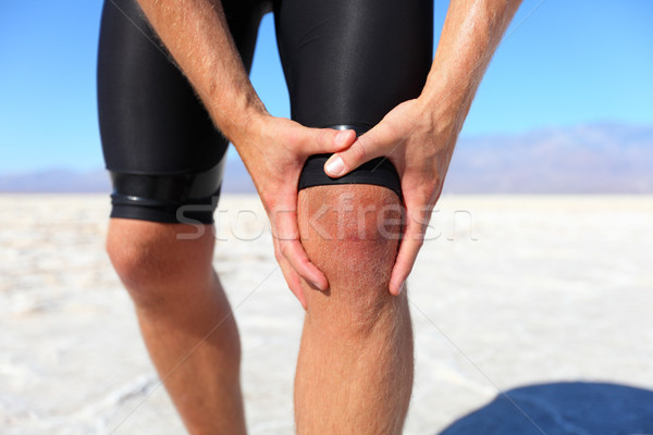 Injuries - sports running knee injury on man Stock photo © Maridav