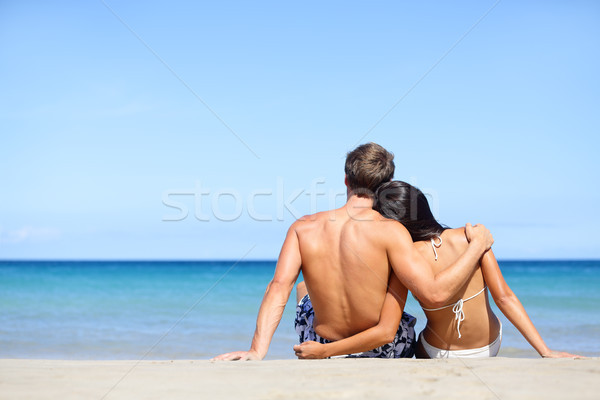 Happy young couple in love relaxing beach vacation Stock photo © Maridav