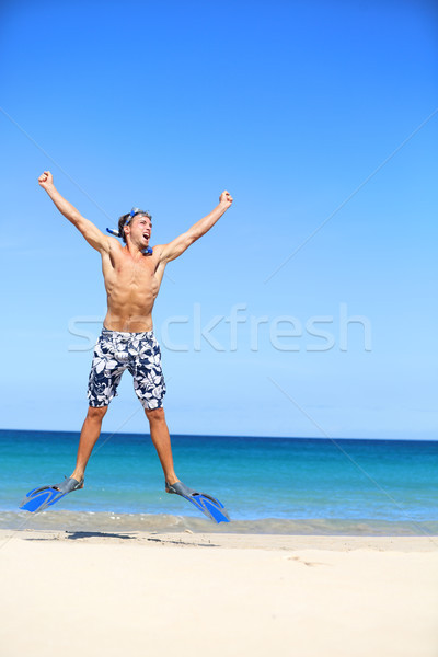 Vacation - happy beach man jumping with snorkeling Stock photo © Maridav
