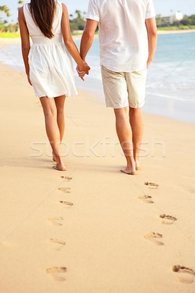 Couple holding hands walking on beach on vacation Stock photo © Maridav