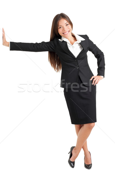 Young Businesswoman Leaning On Wall Stock photo © Maridav