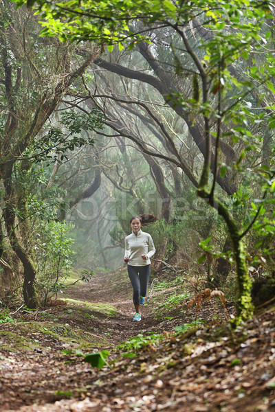Runner woman cross-country running in forest Stock photo © Maridav