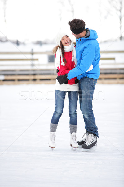 Ice skating couple on date in love iceskating Stock photo © Maridav