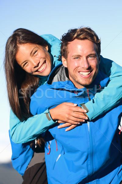 Boldog pár háton aktív életstílus szórakozás Stock fotó © Maridav