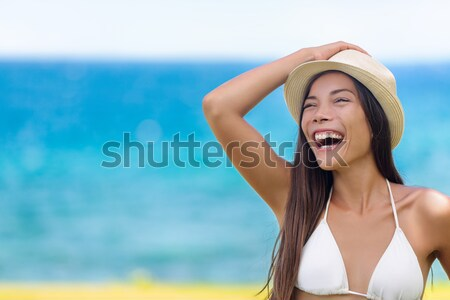 Beach woman happy on travel tanning Stock photo © Maridav
