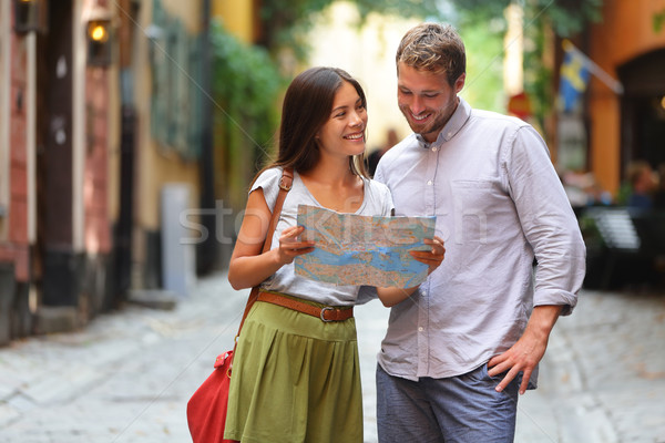 Stockholm tourists couple looking at map. Stock photo © Maridav