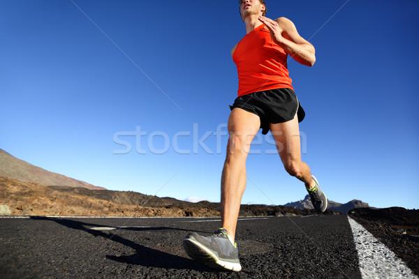 Sprinting running man - male runner training Stock photo © Maridav