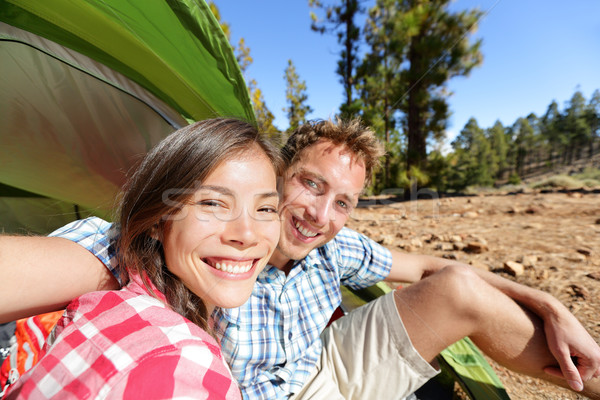Selfie camping couple in tent taking self portrait Stock photo © Maridav