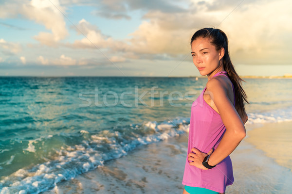 Smartwatch woman on beach living a healthy life Stock photo © Maridav