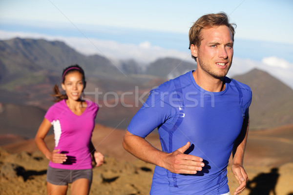 Runners trail running athletes young couple Stock photo © Maridav