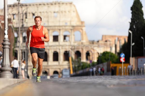 Ejecutando corredor hombre coliseo Roma Italia Foto stock © Maridav