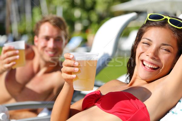 Emberek iszik sör megnyugtató tengerpart üdülőhely Stock fotó © Maridav
