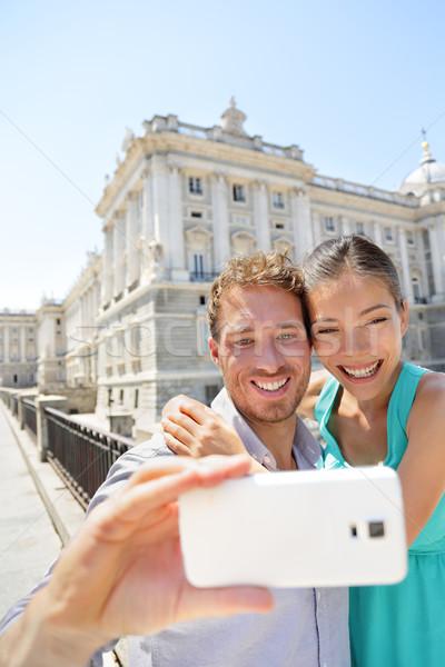 Couple taking selfie photo on smartphone in Madrid Stock photo © Maridav
