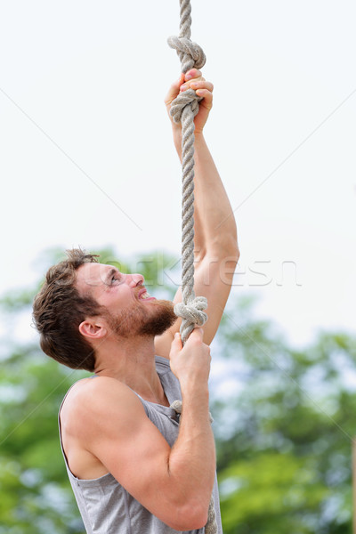 Crossfit man doing rope climb workout climbing Stock photo © Maridav