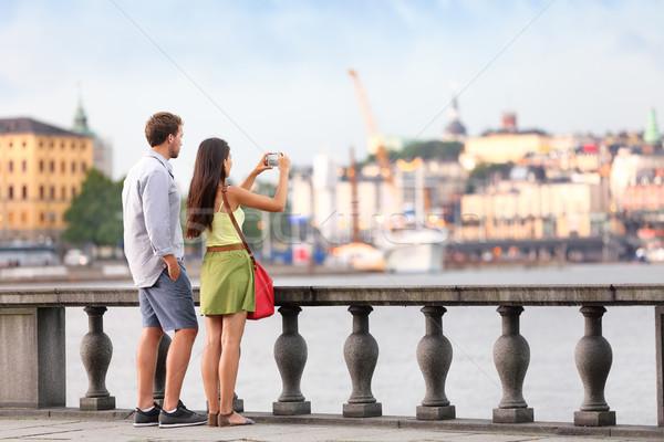 Travel tourists people taking photos in Stockholm Stock photo © Maridav