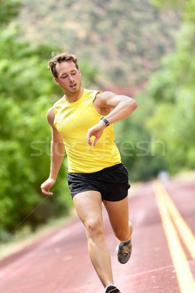 Runner looking at heart rate monitor smart watch Stock photo © Maridav