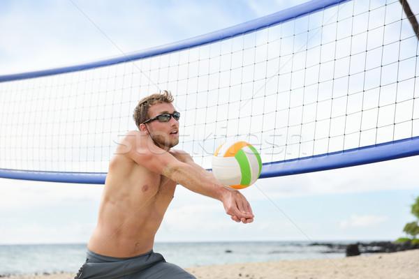 Beach volleyball man playing game hitting ball Stock photo © Maridav