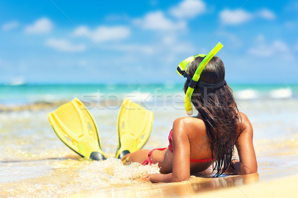 Beach vacation girl snorkeling with mask and fins Stock photo © Maridav