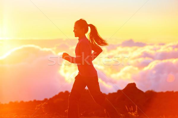 Running - woman runner jogging at sunset Stock photo © Maridav