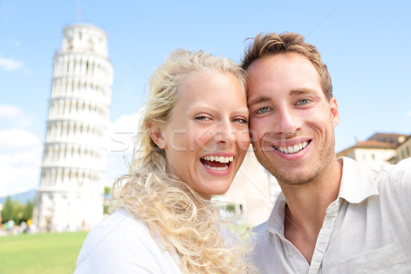 Young couple happy having fun on travel to Pisa Stock photo © Maridav