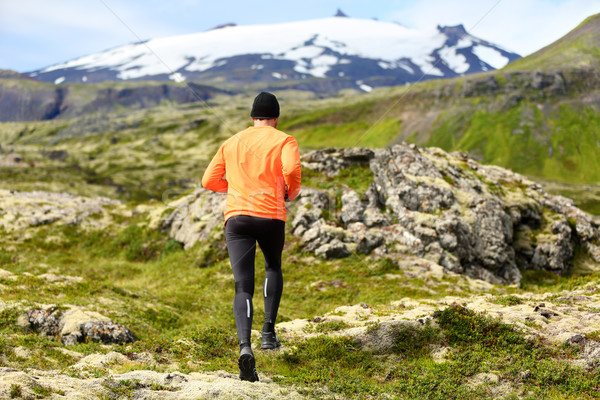Sport athlete - exercising trail runner running Stock photo © Maridav