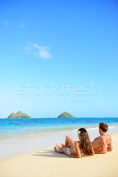 Beach vacations suntan couple relaxing in Hawaii Stock photo © Maridav