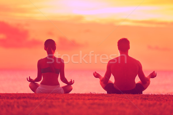 Meditation yoga couple meditating at beach sunset Stock photo © Maridav