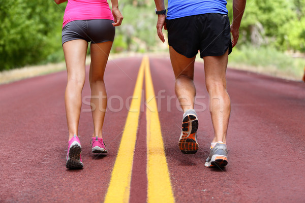 Running people - runners jogging shoes and legs Stock photo © Maridav
