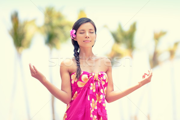 Serene meditation woman meditating on Hawaii beach Stock photo © Maridav