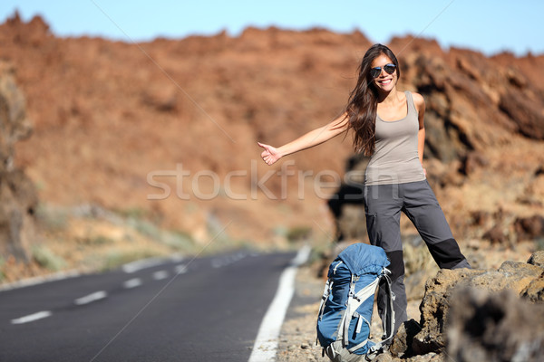 Stock photo: Travel woman hitchhiking