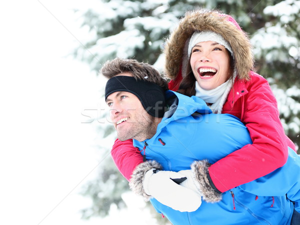 Winter couple happy piggyback Stock photo © Maridav