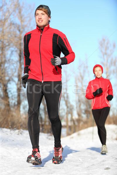 Sport in winter - People running Stock photo © Maridav