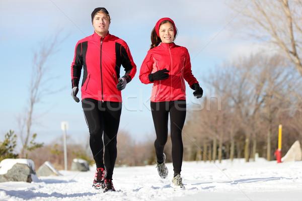Running. Runners exercising in winter Stock photo © Maridav