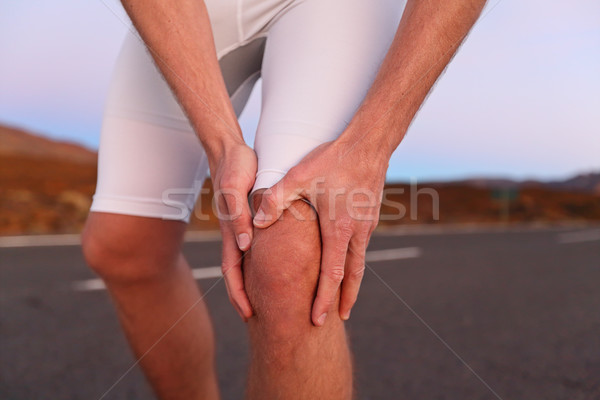 Knee pain - running sport injury Stock photo © Maridav