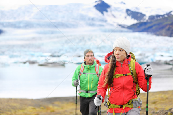 Adventure hiking people by glacier on Iceland Stock photo © Maridav