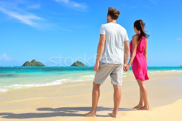 Beach couple looking at ocean view from behind Stock photo © Maridav