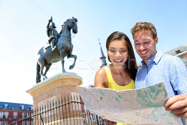 Europe travel couple looking at map in Madrid Stock photo © Maridav