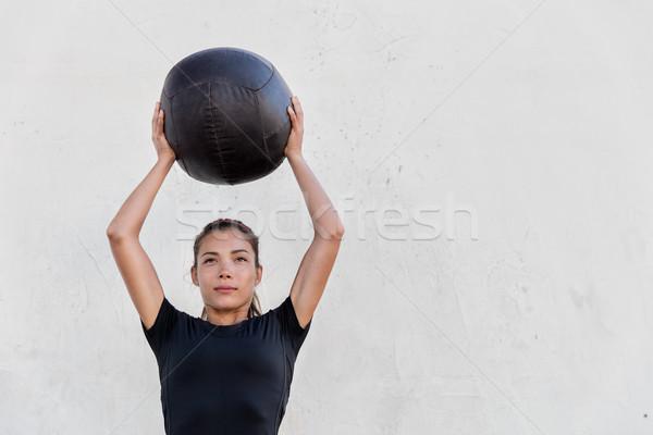 Fitness girl training shoulders with medicine ball Stock photo © Maridav