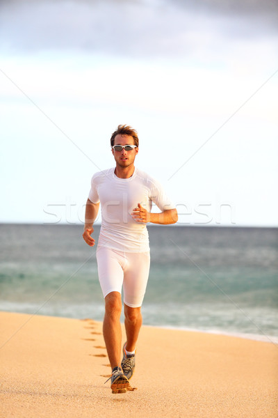 Athlete runner training healthy cardio on beach Stock photo © Maridav