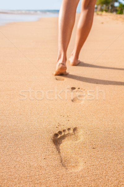 Beach sand footprints woman feet walking barefoot Stock photo © Maridav