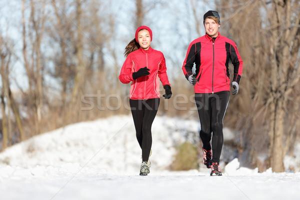 Stock photo: Sport couple running in winter