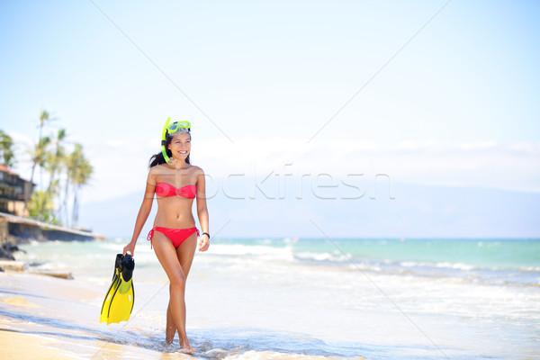 Beach woman walking by ocean - bikini and snorkel Stock photo © Maridav