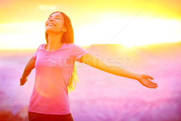 Happy people - free woman enjoying nature sunset Stock photo © Maridav