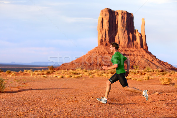 Running man sprinting in Monument Valley Stock photo © Maridav