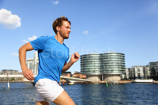 Runner running in urban Copenhagen city Stock photo © Maridav
