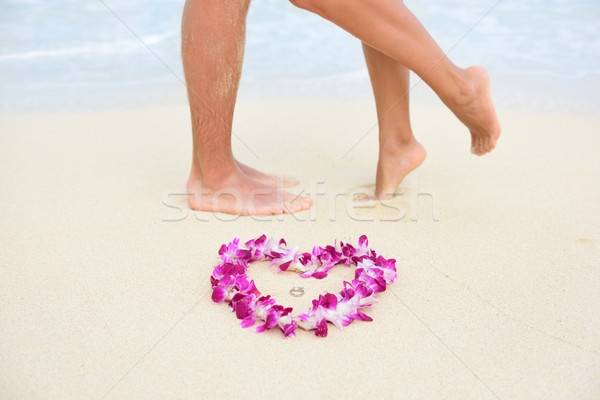 Stock photo: Beach wedding rings with kissing couple feet