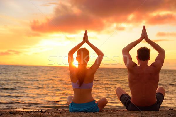 Stock fotó: Jóga · pár · megnyugtató · meditáció · tengerpart · sziluettek