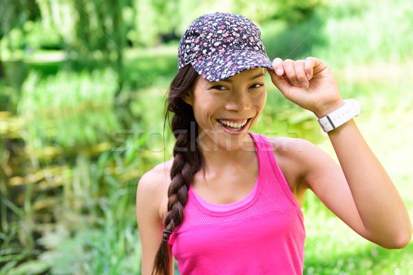 Portré nő futó visel fut sapka Stock fotó © Maridav