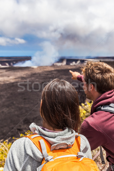 Hiking people looking at Hawaiian volcano Stock photo © Maridav